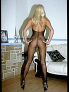Hot blond in fishnet bodystocking takes cum in the mouth