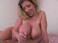 A big tittied milf gives a great handjob POV style here