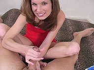 Sexy babe with a shaved snatch giving a great handjob